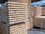 Rounded poles (pins, logs, bars ) made of pine., photo 3
